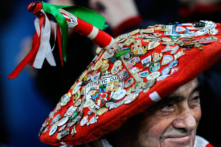 BILBAO, SPAIN - DECEMBER 01:  An Athletic Club wearing a Basque traditional cap covered by badges looks on during the La Liga match between Athletic Club and FC Barcelona at San Mames Stadium on December 1, 2013 in Bilbao, Spain.  (Photo by David Ramos/Getty Images)